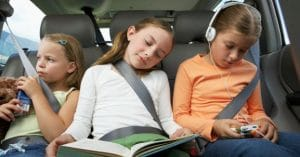 three kids in the backseat