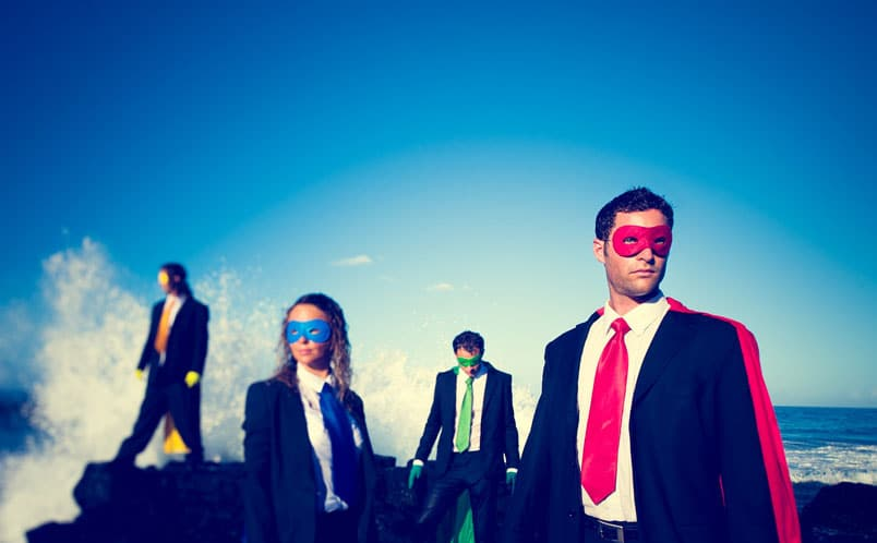 Business men and women posed as superheros